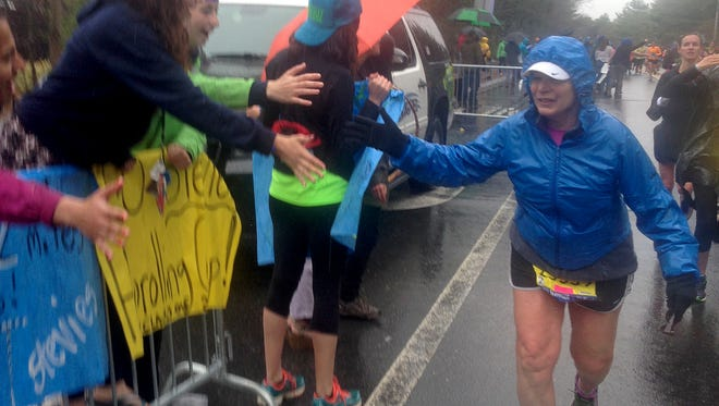 Cancer survivor Nona Cerveny of Scottsdale runs near Wellesley College in her 30th consecutive Boston Marathon on Monday.