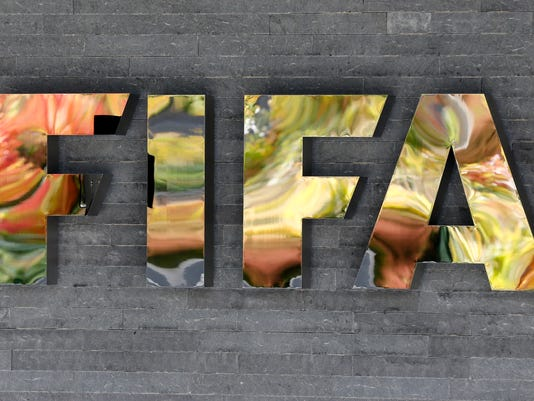 FILE - In this Sept. 25, 2015 file picture the FIFA logo is  pictured on a wall of the FIFA headquarters during a meeting of the FIFA Executive Committee in Zurich, Switzerland  while autumnal colors reflecting .  FIFA's ethics committee has asked for sanctions against Sepp Blatter and Michel Platini after finishing investigations into their alleged financial wrongdoing. FIFA President Blatter and UEFA President Platini now face bans of several years at full hearings before FIFA ethics judge Joachim Eckert, likely in December.  . (AP Photo/Michael Probst)