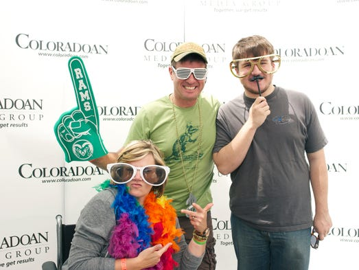 Festival goers pose at the Coloradoan photo booth at Taste of Fort Collins on Saturday June 14, 2014.