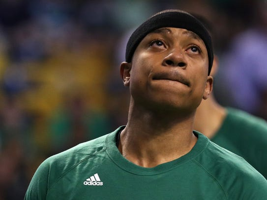 Isaiah Thomas of the Boston Celtics looks on during