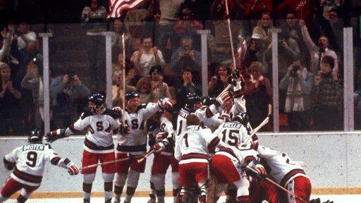 The U.S. hockey team pounces on goalie Jim Craig after a 4-3 victory against the Soviet Union in a medal-round match at the the 1980 Winter Olympics in Lake Placid, N.Y. The United States upset the mighty Soviets in a breathtaking moment freighted with the tension of the Cold War.