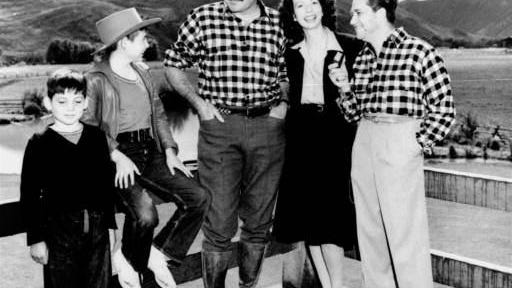 The seldom photographed children of author Ernest Hemingway, Gloria, 8, and Patrick, 12, are shown at Sun Valley, Idaho on October 7, 1940, with their dad, center, and Mr. & Mrs. Mervyn Leroy. Leroy is the famous movie director.