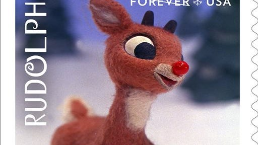 This undated handout provided by the United States Postal Service shows a Limited Edition Forever stamp depicting Rudolph, which was created from still television frames from the 'Rudolph the Red-Nosed Reindeer' television special. Thousands of Christmas cards are pouring into a small Wisconsin village that shares its name with the most famous reindeer. The Rudolph Post Office receives more than 10,000 Christmas cards annually from all over the world to be stamped with festive markings during the holiday season. This year, the local effort coincides with the U.S. Postal Service issuing stamps commemorating the 50th anniversary of the popular television special, 'Rudolph the Red-Nosed Reindeer.' A stolen statue of Rudolph has been recovered in Gardena, Calif.