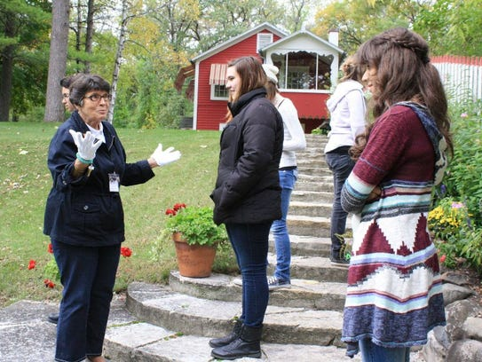 Joan Niquette leads a tour at 10 Chimneys.