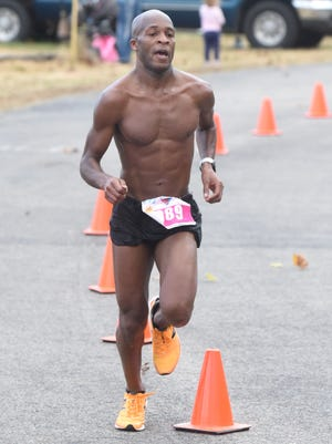 Brandon Gardner of Bentonville nears the finish line of the 14th annual White River Marathon on Saturday morning.
