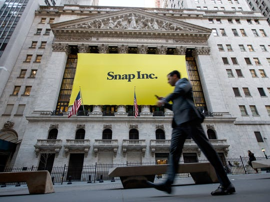 Signage for Snap Inc., parent company of Snapchat, adorns the front of the New York Stock Exchange, March 2, 2017 in New York City. Snap Inc. priced its initial public offering at $17 a share on Wednesday and Snap shares will start trading on the New York Stock Exchange on Thursday.