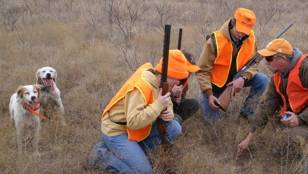 Rodney Sturdivant talks to cadets about the indicators and signs of a quail's roost site.