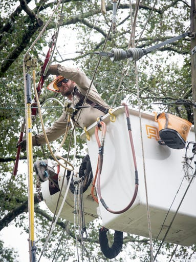 City of Tallahassee utility worker Michael Rainey works