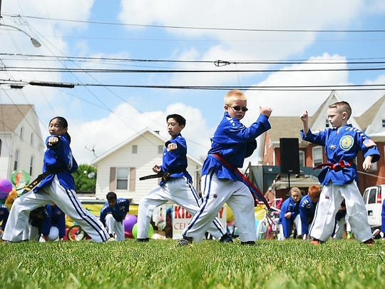 Students from So's Tae Kwon Do perform martial arts moves for a crowd during the Kids' Day Celebration at Wirt Park on Saturday April 30, 2016 in Hanover.