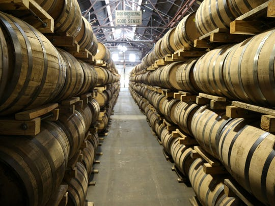 Thousands of bourbon barrels are stacked up at the site of Ken Lewis' New Riff Distilling, Sept. 19, 2017, in Newport, Ky. He put them there this year after buying the property.