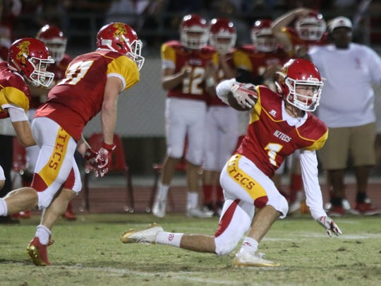 Palm Desert's Jacob McIlroy carries the ball after an interception against Xavier Prep last season. McIlroy is part of a lethal defensive backfield for the Aztecs.