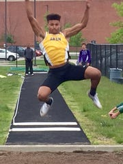 Avon's Isaac Guerendo competes in the long jump in the Hoosier Crossroads Conference meet at Zionsville.  He set a conference record of 23-9.