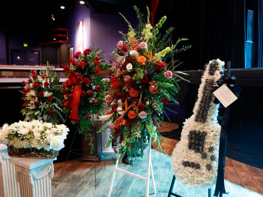 Flower arrangements, including one in the shape of