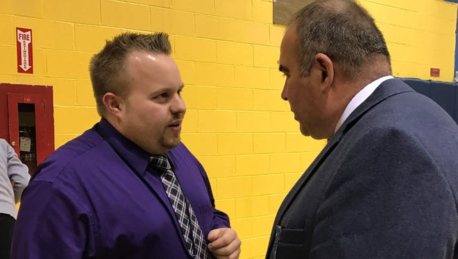 Belleville High School Athletic Director Dan Sanacore, left, an assistant principal, consults with head track and field coach Lenczuk John at the high school Friday, March 31, 2017.