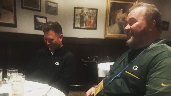 Packers coach Mike McCarthy enjoys a laugh.