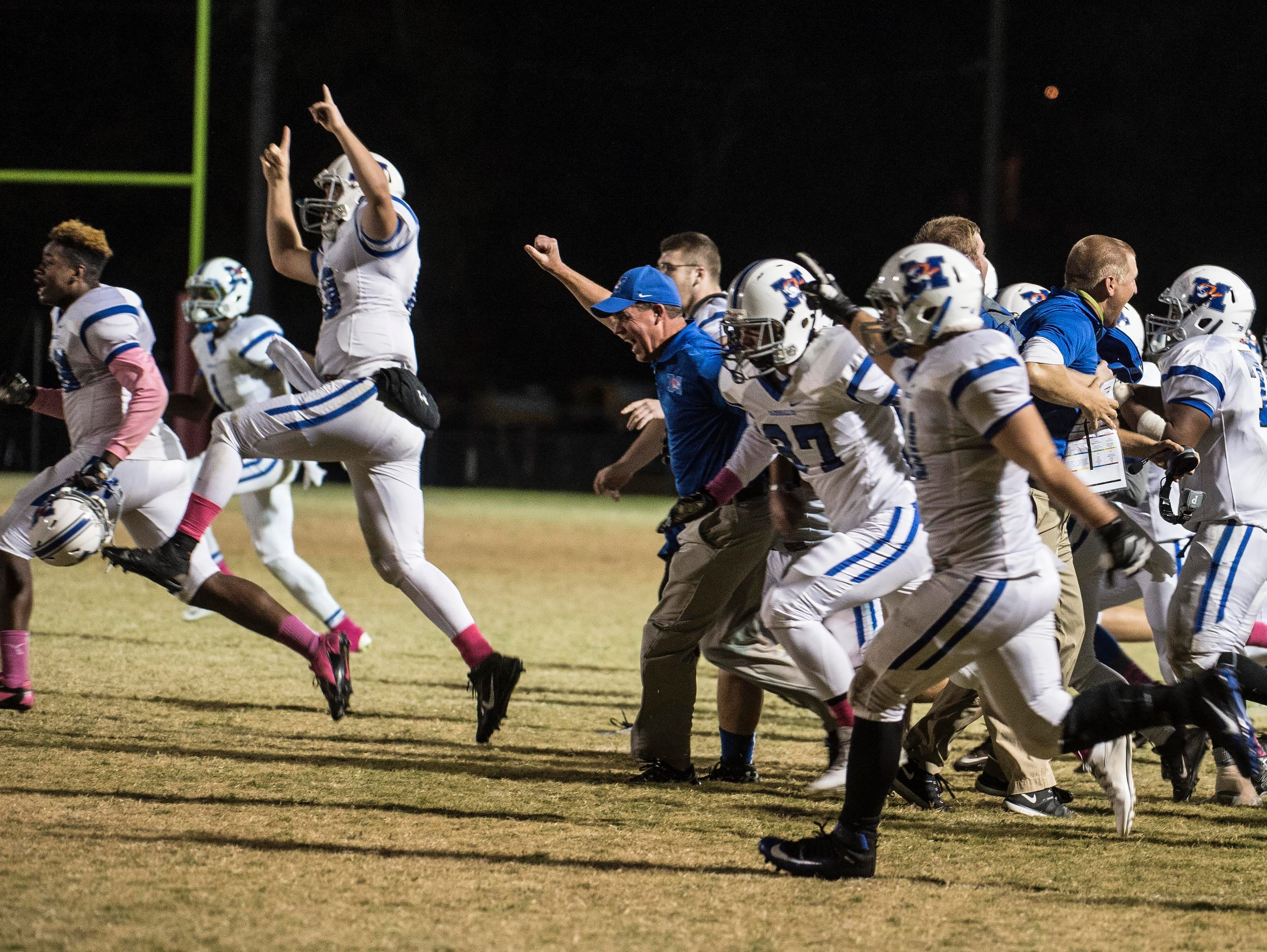 Marshall defeats Maplewood 34-33 in double overtime on Tuesday October 23, , 2014, in Nashville in Tenn.