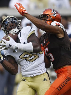 Georgia Tech wide receiver Jalen Camp (80) makes a catch against Bowling Green defensive back Montre Gregory (6) during a game Sept. 29, 2018, in Atlanta.