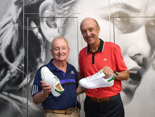 Rod Laver (left) and Stan Smith pose with the adidas
