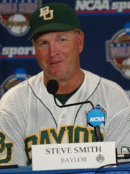 Former Baylor head coach Steve Smith (pictured here during the 2005 College World Series) has been hired as the pitching coach at Auburn.