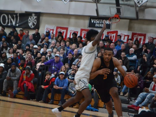 Talen Horton-Tucker drives the baseline during a basketball
