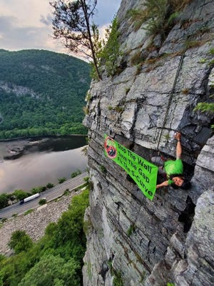 Benjamin Emmett, a local member of Access Fund, and other climbers scaled the east-facing cliffs of Mount Tammany and briefly hung a banner protesting the DOT's project on Monday, June 22, 2020. They took this picture then took the banner down.