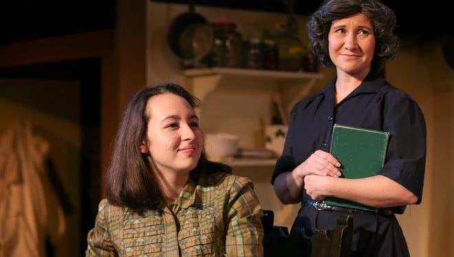 "Anne Frank, played by Esther Whited, and her mother, Edith Frank, played by Sarah Negovetich, hide from the Germans in Be Theatre's production of ""The Diary Of Anne Frank."""