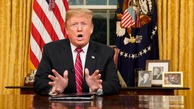 President Donald Trump speaks from the Oval Office of the White House as he gives a prime-time address about border security Tuesday in Washington. (Carlos Barria/Pool Photo via AP)
