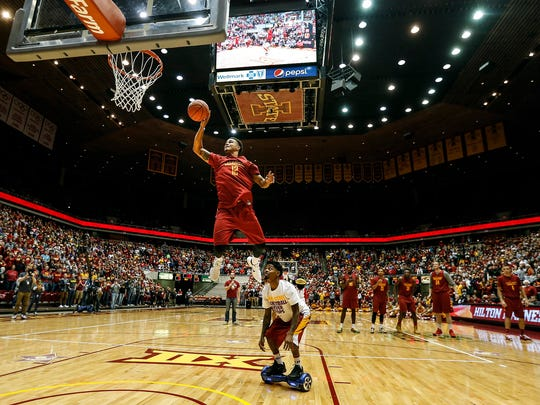 Iowa State's Nick Weiler-Babb jumps over another player during a dunk competition at Hilton Madness on Oct. 16, 2015.