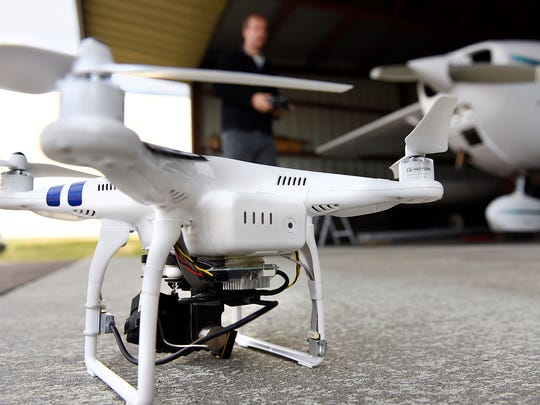 James Aarestad, Eagle Eye Photos, shows the drone he has received an exemption to use complete with the ID number from the FAA Wednesday, Nov. 11 at the Buffalo Municipal Airport