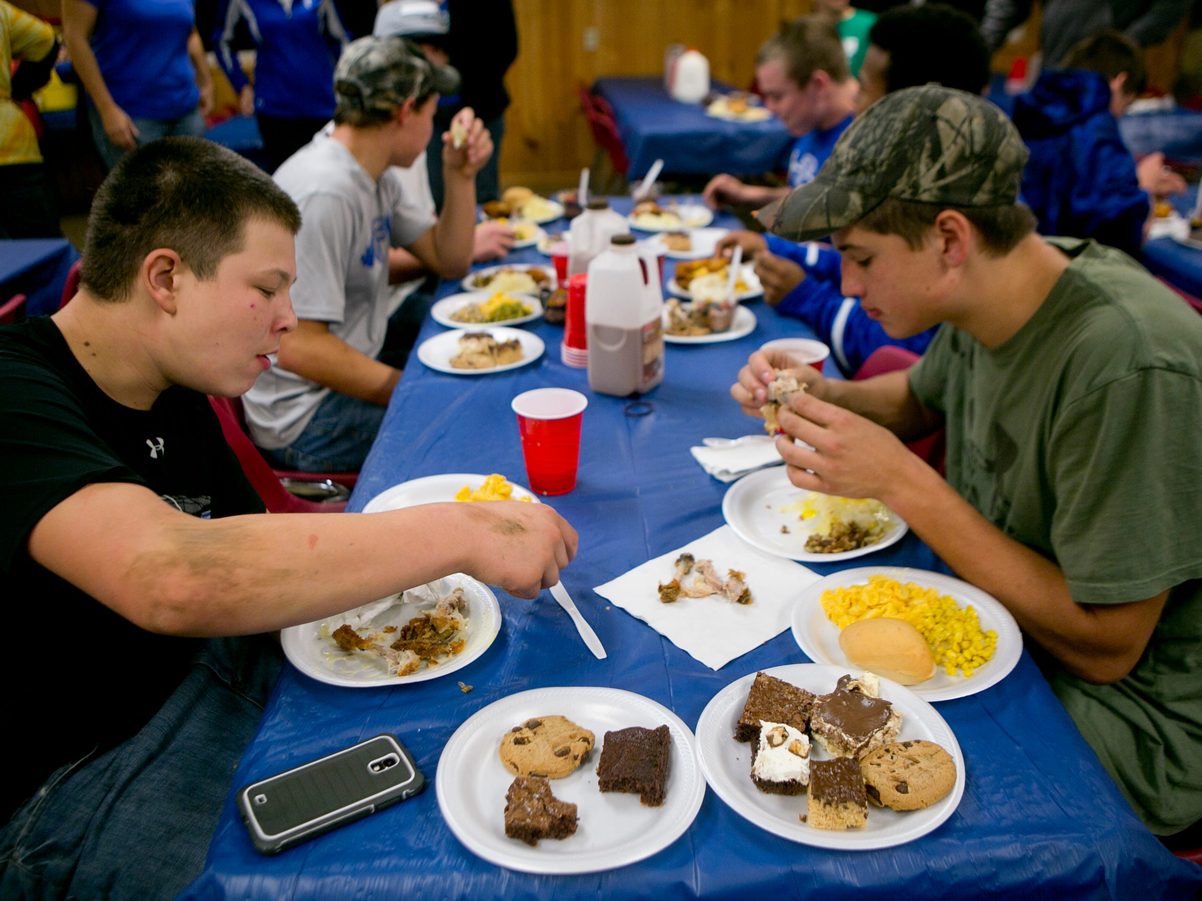 Players eat during the team dinner at the West Lodge at Lake Emily in Amherst, Thursday, Nov. 5, 2015.