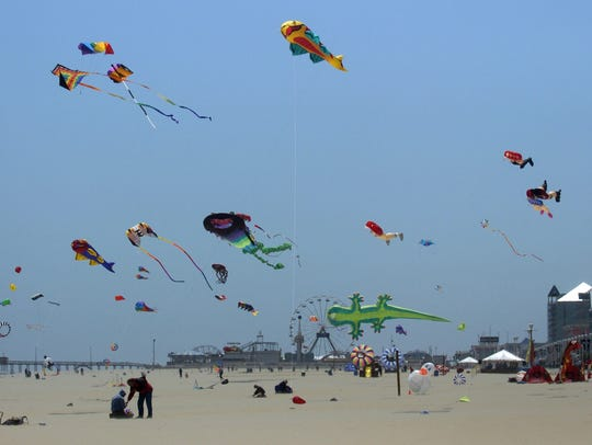 Kites fly in the wind during the Kite Expo on 5th Dtreet