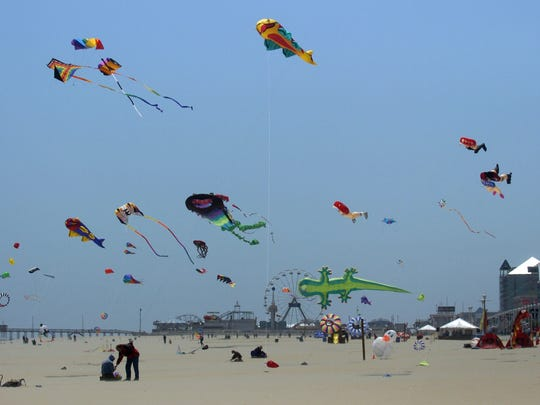 Kites fly in the wind during the Kite Expo on 5th Dtreet and the Boardwalk in Ocean City.