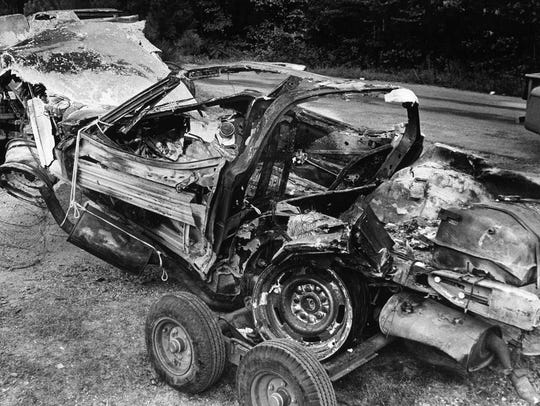 Aug. 21, 1974  Wreckage of Pusser auto, twisted by