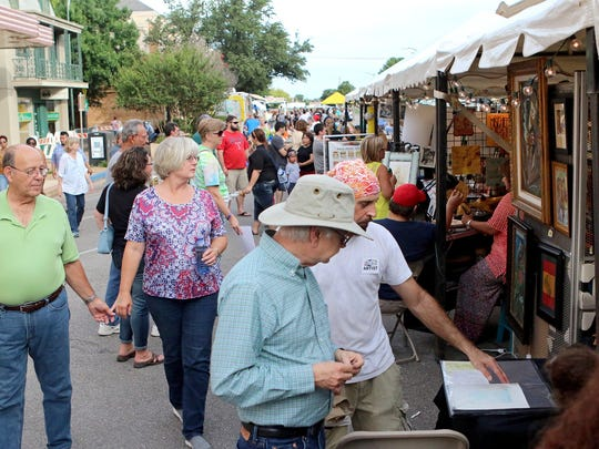 Groups browse through various booths featuring local artists and merchants during Wichita Falls Downtown Development's Art and Soul Festival in 2016.