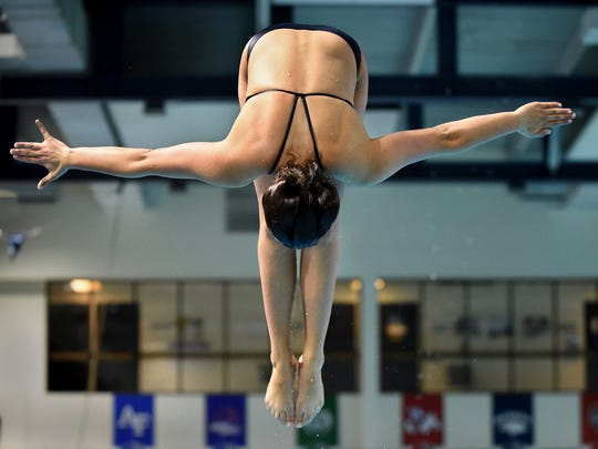 Reno high's Regan Caufield practices her diving at the Lombardi Pool on the UNR campus on May 1. She won the Region diving title last week.
