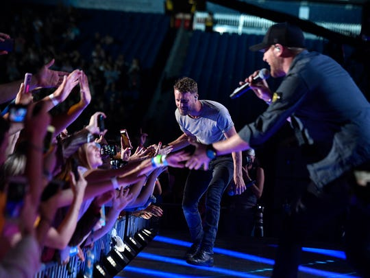 Dierks Bentley and Cole Swindell perform together at
