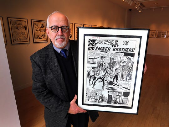 When viewed together, the 40 or so pieces of original comic book art from Charles David Viera's personal collection that are being exhibited through March 10 in Princeton chronicle much of the medium's history. They elude to the advent of censorship through the Comics Code Authority, the dawn of the so-called Silver Age with the reintroduction of The Flash, the birth of Marvel comics and the debut of the first mainstream black hero, the Black Panther. The collection also reveals the rise and fall in popularity of comic book genres such as romance, war, horror and this example of westerns. Here he holds Rawhide Kid No. 32 (Marvel Comics, 1963), penciled by Viera's favorite artists, Jack Kirby, with Dick Ayers' inks on top.