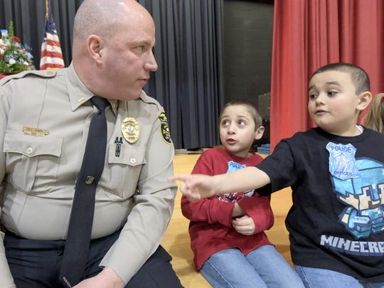Leib Elementary first-graders Jordan McClane, right, and Isaiah Lopez talk with Northern Regional Police Lt. Dave Lash during an appreciation lunch at the school Friday, March 16, 2018. Lash is now deputy chief of Northern York County Regional Police.