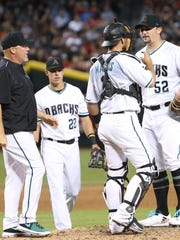 Diamondbacks pitching coach Mike Butcher comes to the