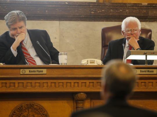 Councilman Kevin Flynn (left) and Vice Mayor David Mann listen at Tuesday's hearing.