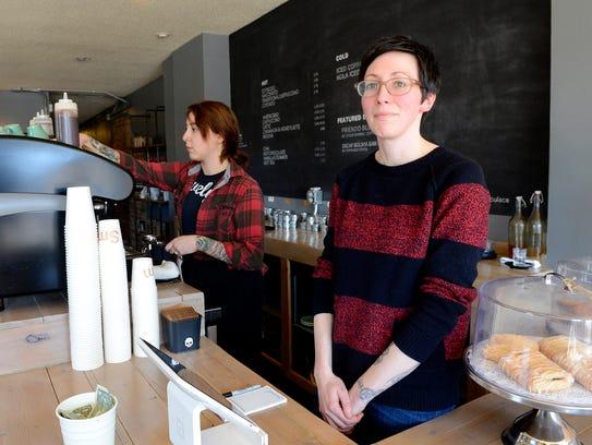 Strange Matter owner Cara Nader stands behind the counter