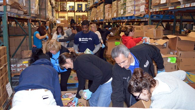 More than 40 Atlantic City Electric employees, their family members and friends recently volunteered at the Community FoodBank of New Jersey, Southern Branch in Egg Harbor Township. Volunteers packed boxes with donated food for residents in need. To support this volunteer event, Atlantic City Electric held food drives across various company locations resulting in nearly 1,700 pounds of food collected to help stock the cupboards of the FoodBank.