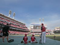 Matt Holliday watches batting practice with his sons during the pre-Home Run Derby workout at Great American Ballpark.