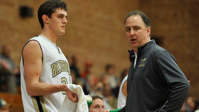 Hayesville junior Zach Cottrell, pictured here with his father and Yellow Jackets coach Michael Cottrell, is a two-time Big Smoky Mountain Conference Player of the Year.