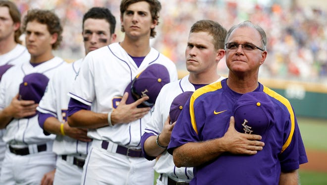 LSU Tigers head coach Paul Mainieri (1) observes the national anthem prior to the game against the UCLA Bruins during the 2013 College World Series at TD Ameritrade Park.