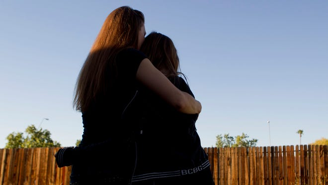 An immigrant from Eastern Europe says she fled from an abusive husband with her daughter to start a new life. But because she has a work permit under a deferred-action program, she will lose her Arizona driver's license.