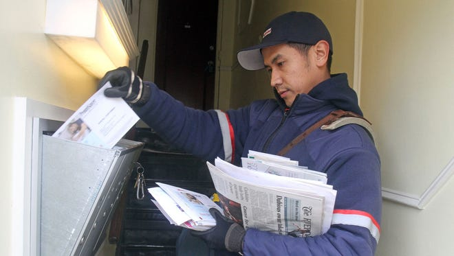 Tonipet Magtibay delivers mail in Irvington, N.Y.