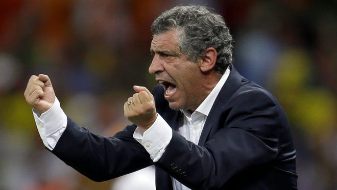 Greece's head coach Fernando Santos as he shouts  instructs his players during the group C World Cup soccer match between Greece and Ivory Coast at the Arena Castelao in Fortaleza, Brazil.