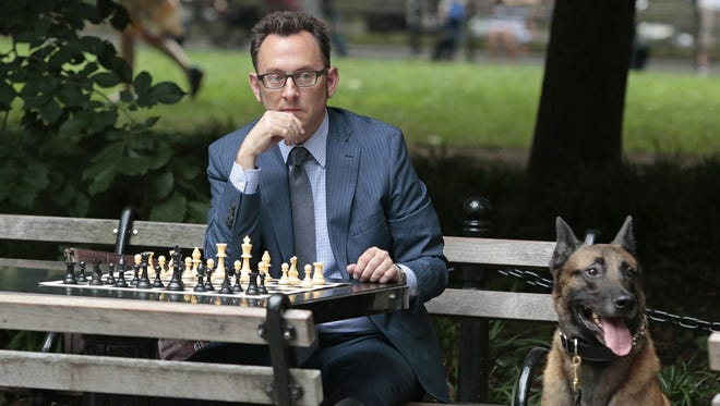 Finch (Michael Emerson) ponders his next move in the fourth-season premiere of 'Person of Interest.'