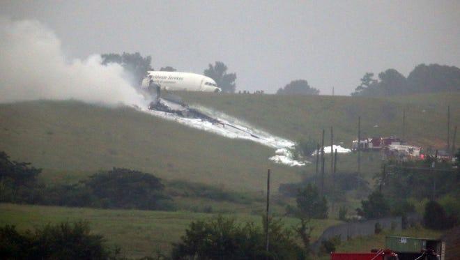 A UPS cargo plane lies on a hill near Birmingham-Shuttlesworth International Airport after crashing on approach on Aug. 14.